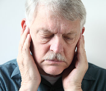 A man feeling Acoustic Neuroma Pressure-SL Hunter Speechworks