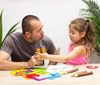 A dad helping daughter with Articulation Difficulties-SL Hunter Speechworks