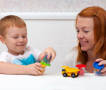 A mother helps her toddler with phonology-SL Hunter Speechworks
