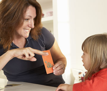 A mother guides her daughter with speech clarity techniques-SL Hunter Speechworks
