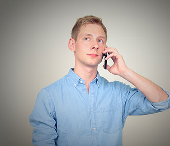 Young man stuttering on phone call, treated by S.L. Hunter Speechworks in Burlington Ontario