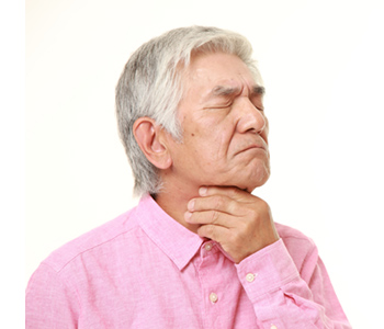 a man touching his throat from vocal polyps-SL Hunter Speechworks