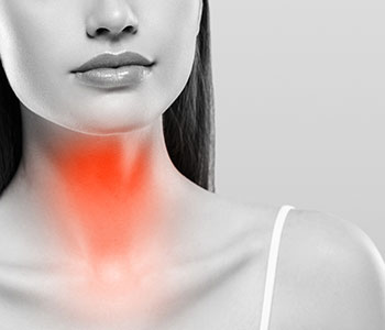 woman with throat highlighted in red to show a laryngectomy, treated by S.L. Hunter Speechworks in Burlington Ontario