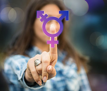 young women with finger on transgender symbol for transgender voice training